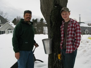 James and Michael tapping our first maple.